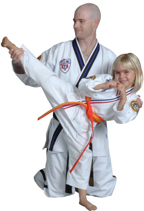 instructor teaching young girl how to kick